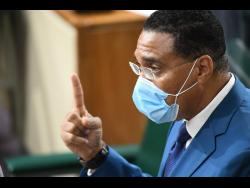Prime Minister Andrew Holness making his presentation on COVID-19 in Parliament on Wednesday.