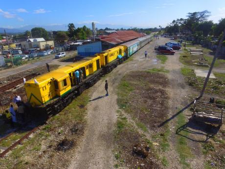 A Jamaica Railway Corporation train is seen at the Spanish town railway station.