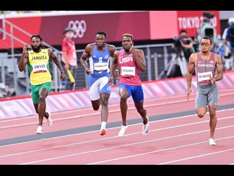 Jamaica's Rasheed Dwyer runs along with (from left) Liberia's Joseph Fahnbulleh, the United States' Kenneth Bednarek and Canada's Andre De Grasse in the men's 200 metres final at the Tokyo 2020 Olympics yesterday.